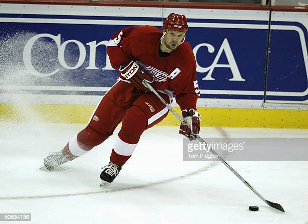 Defenseman Nicklas Lidstrom of the Detroit Red Wings controls the puck against the Calgary Flames in game 5 of the Western Conference Semifinals...