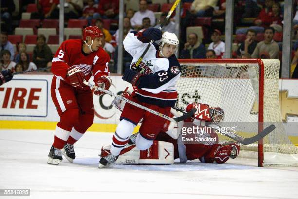 Defenseman Nicklas Lidstrom of the Detroit Red Wings protects the net from forward Gilbert Brule of the Columbus Blue Jackets during the preseason...
