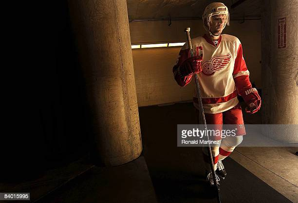Defenseman Nicklas Lidstrom of the Detroit Red Wings walks to the ice before the game against the Dallas Stars at the American Airlines Center on...