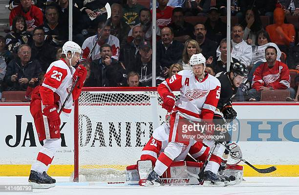 Defenseman Niklas Kronwall of the Detroit Red Wings defends Bobby Ryan of the Anaheim Ducks in the crease area during the NHL game at Honda Center on...