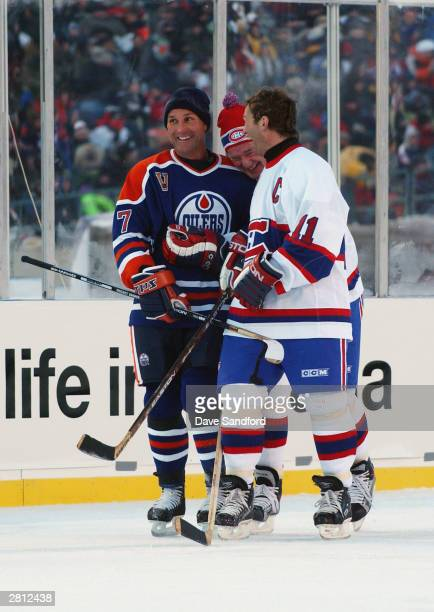 Defenseman Paul Coffey of the Edmonton Oilers shares a laugh with Larry Robinson and Kirk Muller of the Montreal Canadiens during the Molson Canadien...