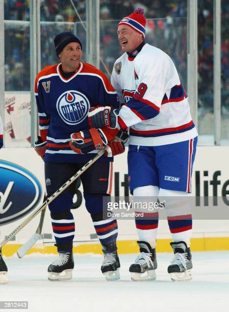 Defenseman Paul Coffey of the Edmonton Oilers shares a laugh with Larry Robinson of the Montreal Canadiens during the Molson Canadien Heritage...