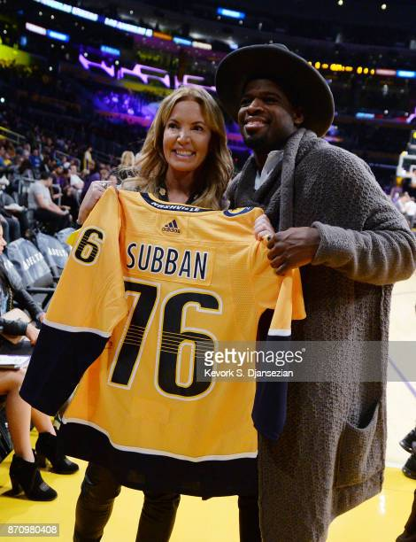 Defenseman PK Subban of the Nashville Predators poses Jeanie Buss controlling owner and president of the Los Angeles Lakers after presenting her with...