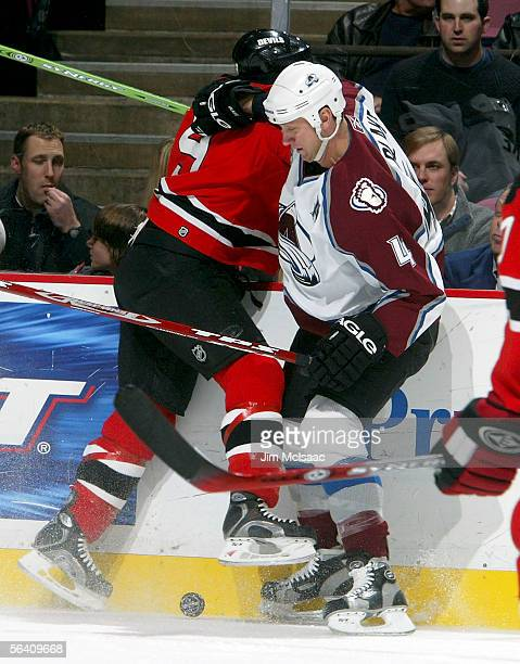 Defenseman Rob Blake of the Colorado Avalanche plays the puck against Zach Parise of the New Jersey Devils during their game on December 9 2005 at...