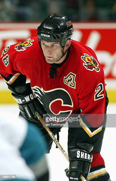 Defenseman Robyn Regehr of the Calgary Flames waits for the puck during the game against the San Jose Sharks at The Pengrowth Saddledome on October...