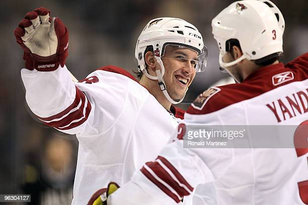 Defenseman Sami Lepisto of the Phoenix Coyotes celebrates a goal with Keith Yandle against the Dallas Stars in the first period at American Airlines...