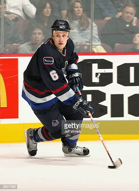 Defenseman Sami Salo of the Vancouver Canucks skates with the puck against the Edmonton Oilers during the NHL game on October 11, 2003 at General...
