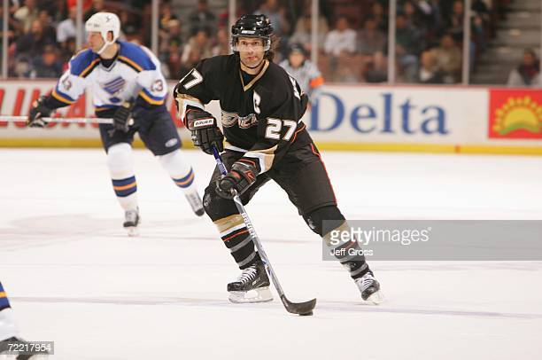 Defenseman Scott Niedermayer of the Anaheim Ducks skates with the puck during the NHL game against the St. Louis Blues at the Honda Center on October...