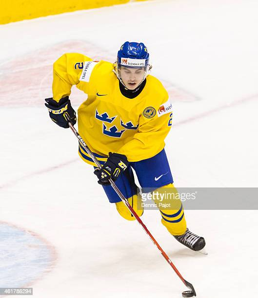Defenseman Sebastian Aho of Sweden moves the puck against Slovakia during the Bronze medal game of the 2015 IIHF World Junior Championship on January...