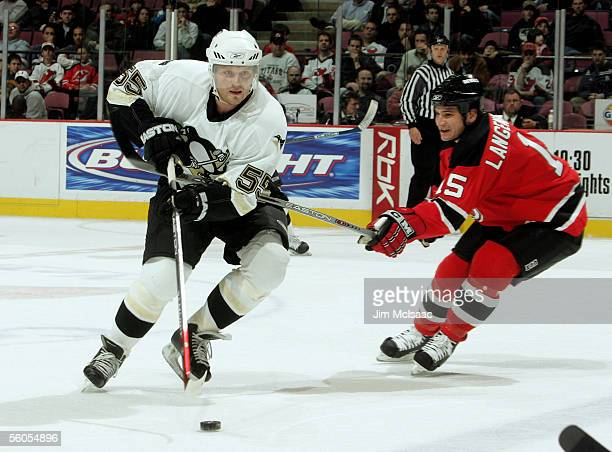 Defenseman Sergei Gonchar of the Pittsburgh Penguins skates past right wing Jamie Langenbrunner of the New Jersey Devils November 1, 2005 at...