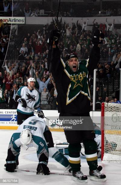 Defenseman Sergei Zubov of the Dallas Stars celebrates after scoring the game tying goal in front of Josh Gorges of the San Jose Sharks on January 30...