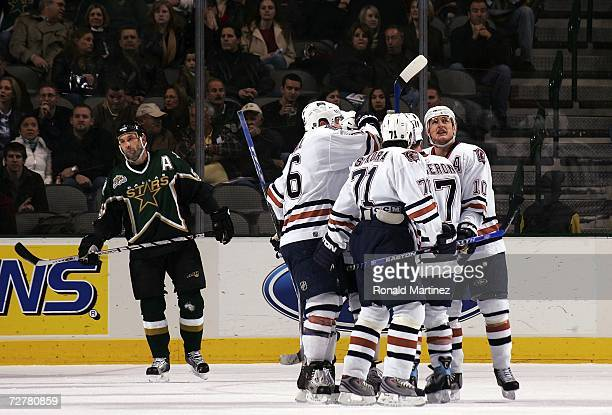 Defenseman Sergei Zubov of the Dallas Stars skates past the Edmonton Oilers as they celebrate a goal by Marc-Andre Bergeron at the American Airlines...