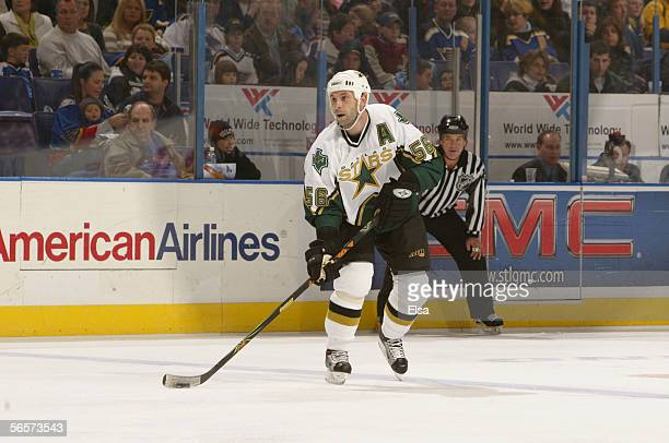 Defenseman Sergei Zubov of the Dallas Stars skates with the puck against the St Louis Blues on December 26 2005 at the Savvis Center in St Louis...