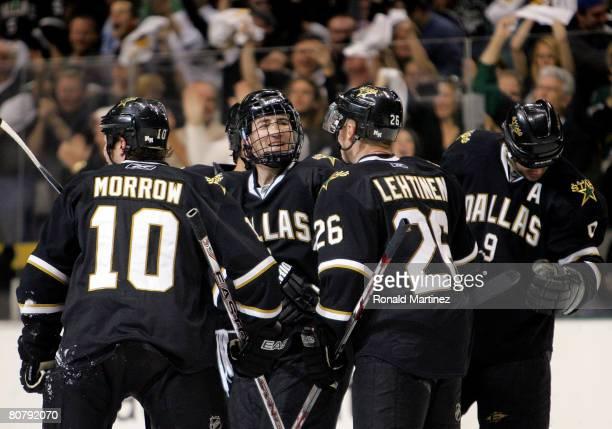 Defenseman Stephane Robidas celebrates a goal with Brenden Morrow Jere Lehtinen and Mike Modano of the Dallas Stars against the Anaheim Ducks during...