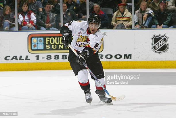 Defenseman Theo Peckham of the Owen Sound Attack plays the puck against the London Knights during their OHL game at the John Labatt Centre November...