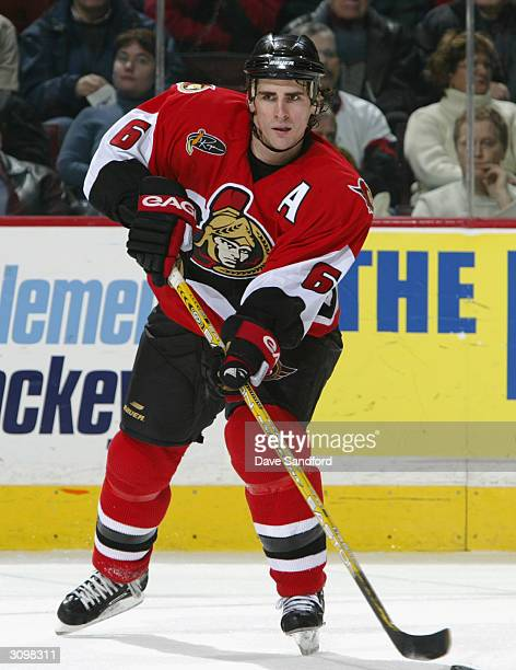 Defenseman Wade Redden of the Ottawa Senators passes the puck during the game against the Pittsburgh Penguins at Corel Centre on January 22, 2004 in...