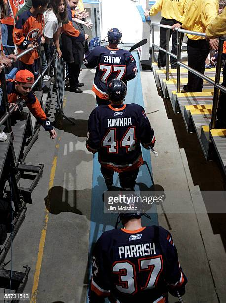 Defensemen Alexei Zhitnik and Janne Niinimaa and left wing Mark Parrish of the New York Islanders take to the ice against the New York Rangers in...