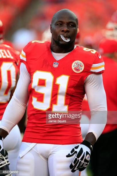 Defensice lineman Tamba Hali of the Kansas City Chiefs warms up prior to the start of the preseason game against the Minnesota Vikings at Arrowhead...