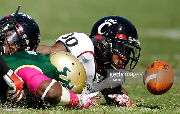 Defensive back Aaron Roberson of the Cincinnati Bearcats watches a fumble slip away against the South Florida Bulls during the game at Raymond James...