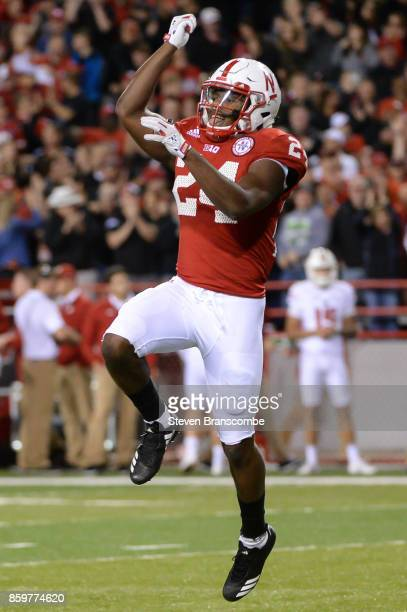 Defensive back Aaron Williams of the Nebraska Cornhuskers celebrates after scoring against the Wisconsin Badgers at Memorial Stadium on October 7...