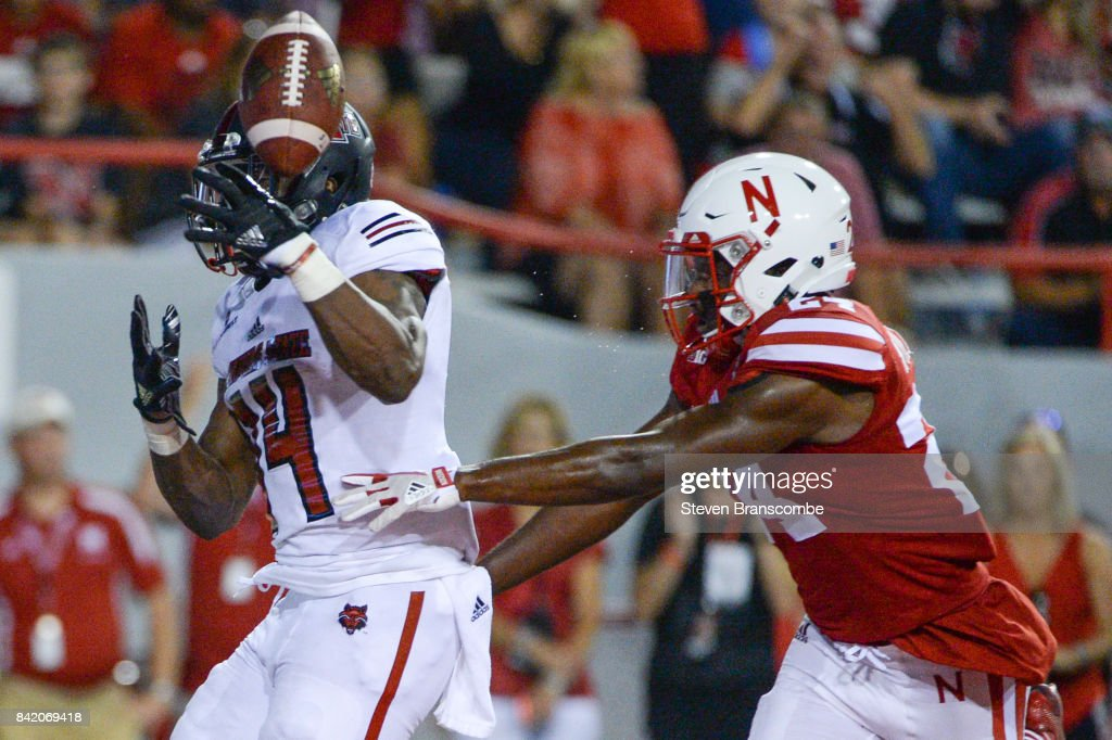 Defensive back Aaron Williams #24 of the Nebraska Cornhuskers tips a potential touchdown from the hands of wide receiver Chris Murray #14 of the Arkansas State Red Wolves at Memorial Stadium on September 2, 2017 in Lincoln, Nebraska.