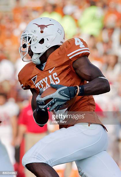 Defensive back Aaron Williams of the Texas Longhorns runs for a touchdown after grabbing an interception against the Arkansas Razorbacks in the...