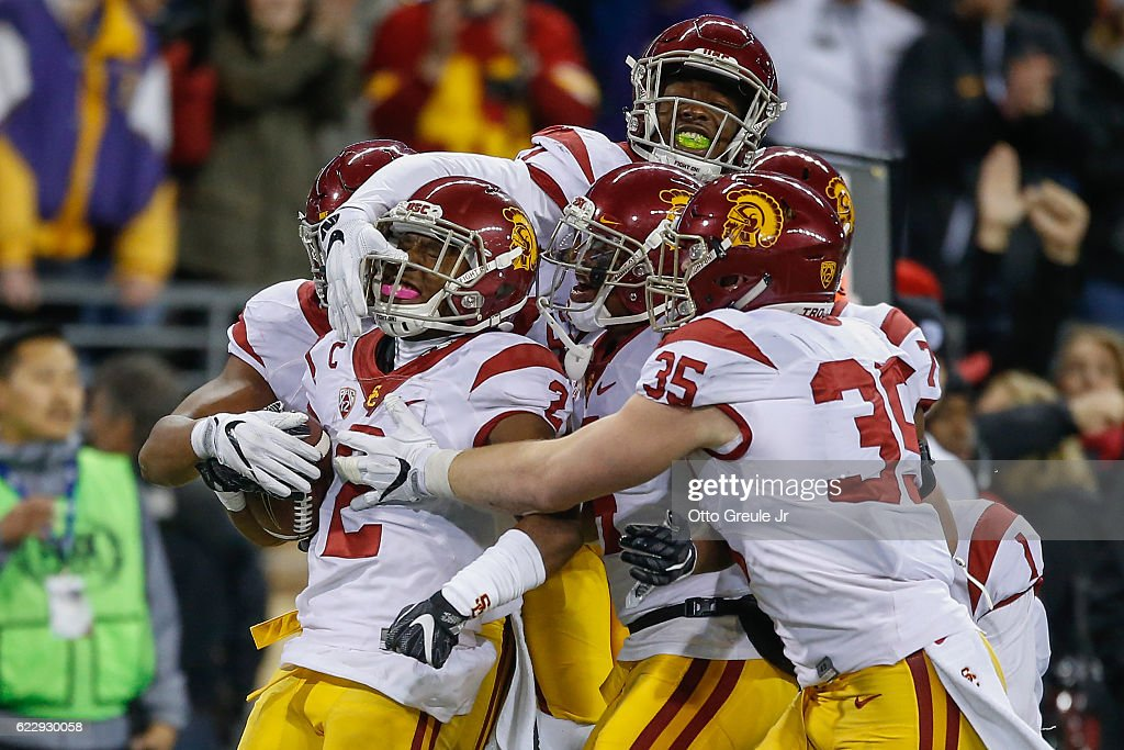 Defensive back Adoree' Jackson #2 of the USC Trojans is congratulated by teammates after making an interception in the fourth quarter against the Washington Huskies on November 12, 2016 at Husky Stadium in Seattle, Washington. The Trojans defeated the Huskies 24-13.