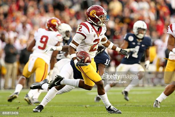 Defensive back Adoree' Jackson of the USC Trojans runs with the ball in the first half as linebacker Brandon Bell of the Penn State Nittany Lions...
