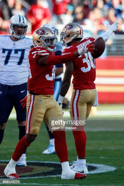 Defensive back Adrian Colbert of the San Francisco 49ers celebrates after recovering a fumble against the Tennessee Titans during the second quarter...