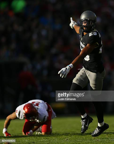Defensive back Ahkello Witherspoon of the Colorado Buffaloes celebrates after breaking up a pass intended for wide receiver Gabe Marks of the...