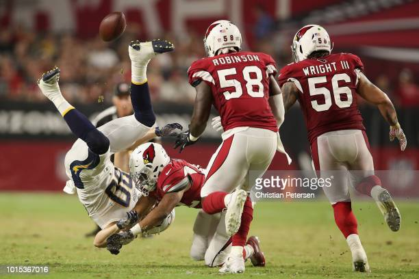 Defensive back A.J. Howard of the Arizona Cardinals attempts to knock the ball from tight end Sean Culkin of the Los Angeles Chargers during the...