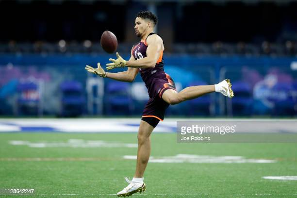 Defensive back Alijah Holder of Stanford tries to hang onto the ball during day five of the NFL Combine at Lucas Oil Stadium on March 4 2019 in...
