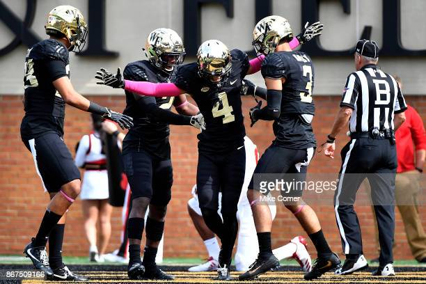 Defensive back Amari Henderson of the Wake Forest Demon Deacons celebrates after breaking up a pass against the Louisville Cardinals during the...