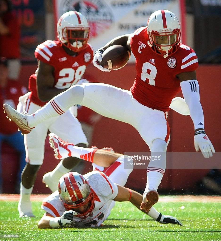 Defensive back Anthony Cioffi #31 of the Rutgers Scarlet Knights tries to trip up running back Ameer Abdullah #8 of the Nebraska Cornhuskers during their game at Memorial Stadium on October 25, 2014 in Lincoln, Nebraska. Nebraska defeated Rutgers 42-24.