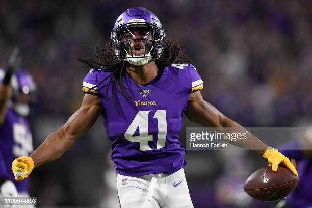 Defensive back Anthony Harris of the Minnesota Vikings celebrates after an interception in the second quarter of the game against the Green Bay...