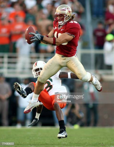 Defensive back Anthony Houllis of the Florida State Seminoles intercepts a pass in front of receiver Sam Shields of the University of Miami...
