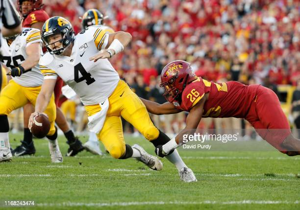 Defensive back Anthony Johnson of the Iowa State Cyclones sacks quarterback Nate Stanley of the Iowa Hawkeyes as he scrambled for yards in the first...