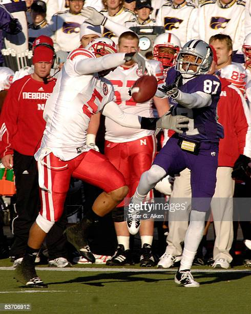 Defensive back Anthony West of the Nebraska Cornhuskers brakes up a pass intended for wide receiver Deon Murphy of the Kansas State Wildcats during...
