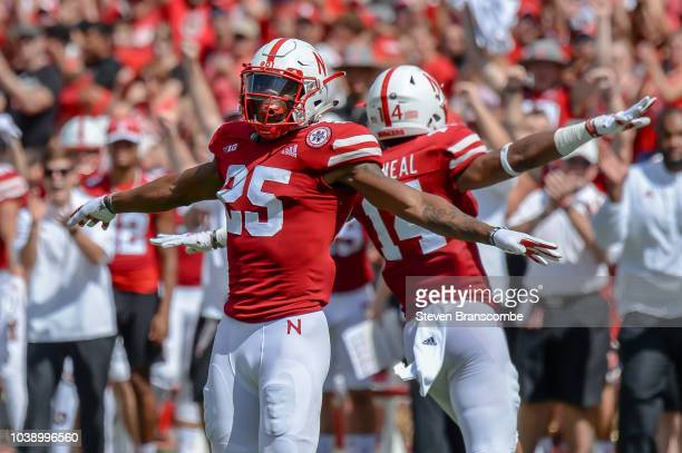 Defensive back Antonio Reed of the Nebraska Cornhuskers celebrates a stop with defensive back Tre Neal against the Troy Trojans at Memorial Stadium...