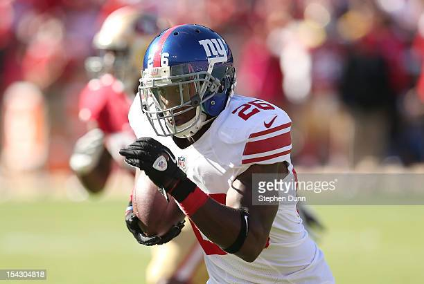 Defensive back Antrel Rolle of the New York Giants returns his first of two interceptions of the third quarter against the San Francisco 49ers at...