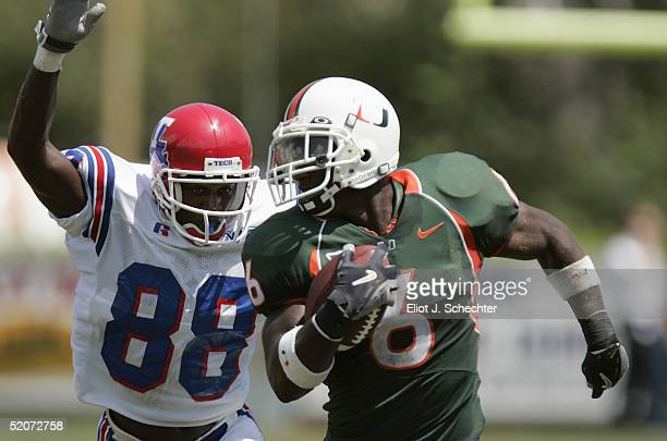 Defensive back Antrel Rolle of the University of Miami Hurricanes runs upfield from wide receiver Tramissian Davis of the Louisiana Tech Bulldogs...