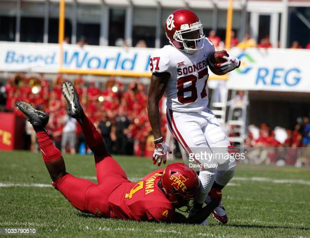 Defensive back Arnold Azunna of the Iowa State Cyclones tackles wide receiver Myles Tease of the Oklahoma Sooners as he rushed for yards in the...