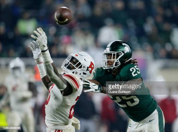 Defensive back Avery Young of the Rutgers Scarlet Knights breaks up a pass intended for wide receiver Darrell Stewart Jr #25 of the Michigan State...