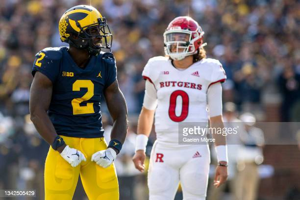 Defensive back Brad Hawkins of the Michigan Wolverines celebrates after sacking quarterback Noah Vedral of the Rutgers Scarlet Knights in the first...