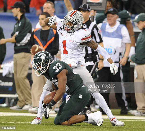 Defensive back Bradley Roby of the Ohio State Buckeyes celebrates after tackling running back Jeremy Langford of the Michigan State Spartans during a...