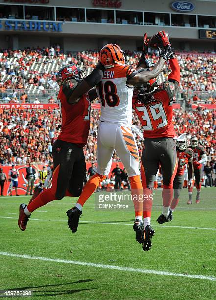 Defensive back Brandon Dixon of the Tampa Bay Buccaneers intercepts a pass in front of wide receiver AJ Green of the Cincinnati Bengals in the second...