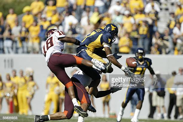 Defensive back Brandon Flowers of the Virginia Tech Hokies helps to break up a pass intended for wide receiver Brandon Myles of the West Virginia...