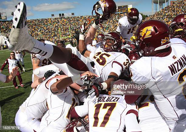 Defensive back Brandon Greer of the Central Michigan Chippewas celebrates with teammates at the end of the game against the Iowa Haweyes on September...