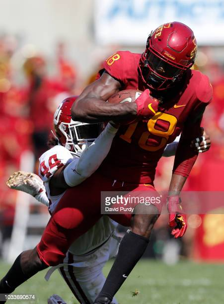 defensive back Brendan RadleyHiles of the Oklahoma Sooners tackles wide receiver Hakeem Butler of the Iowa State Cyclones as he rushed for yards in...