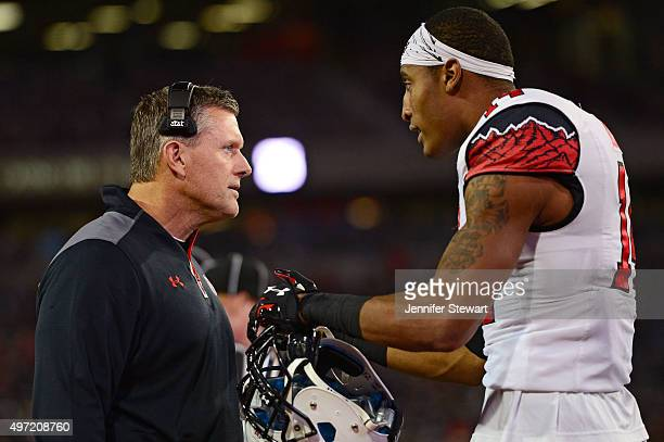 Defensive back Brian Allen of the Utah Utes talks with head coach Kyle Whittingham on the sidelines in the game against the Arizona Wildcats at...